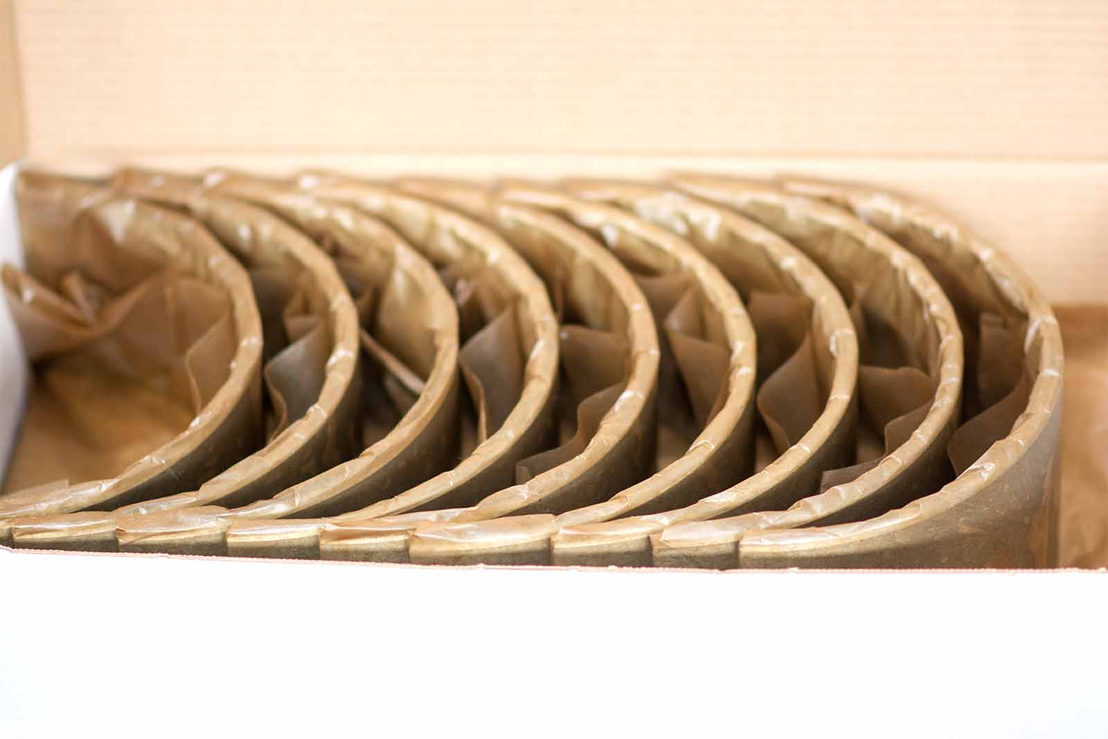 Упакованные вкладыши в парафинированной бумаге